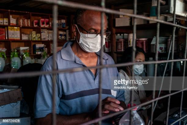 A man wearing a face mask works in Antananrivo Madagascar as plague spreads rapidly in cities across the country on October 2 2017 Twenty people have...