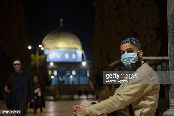 A man wearing a face masks is seen at AlAqsa Mosque Compound at night in March 5 2020 AlAqsa began to be sterilized before and after the prayers due...