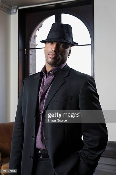 man wearing a fedora - fedora stock pictures, royalty-free photos & images