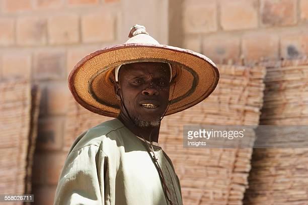 Man wearing a Fulani Straw Hat Monday Market Djenne Mali