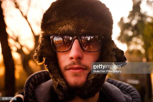 Man wearing a furry hat