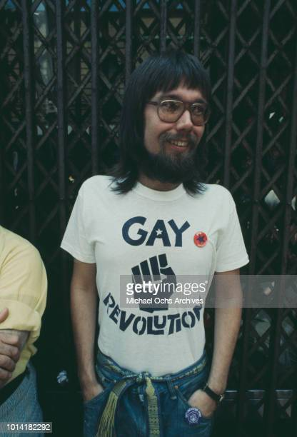 A man wearing a 'Gay Revolution' tshirt at an LGBT parade through New York City on Christopher Street Gay Liberation Day 1971