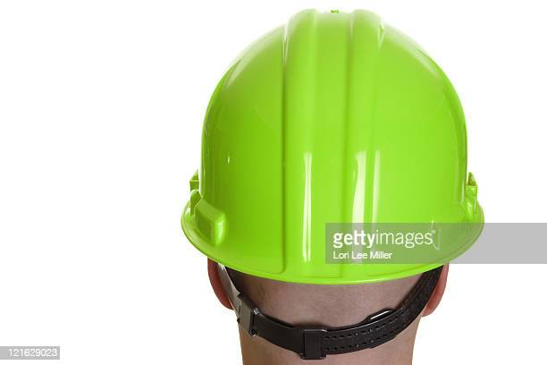man wearing a green hardhat on white - lori lee stock pictures, royalty-free photos & images