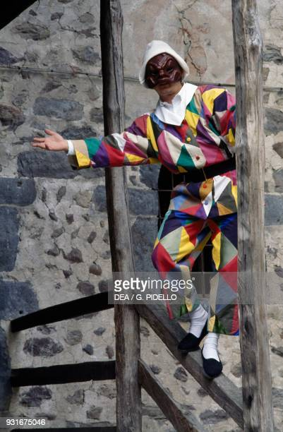 Man wearing a harlequin mask Oneta Lombardy Italy
