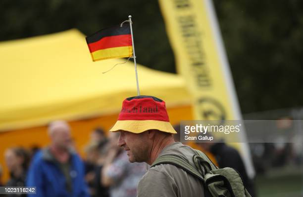 A man wearing a hat in the colors of the German flag attends a gathering hosted by the Identitarian Movement on August 25 2018 in Dresden Germany The...