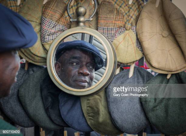 man wearing a hat reflected in a mirror - gary colet stock pictures, royalty-free photos & images