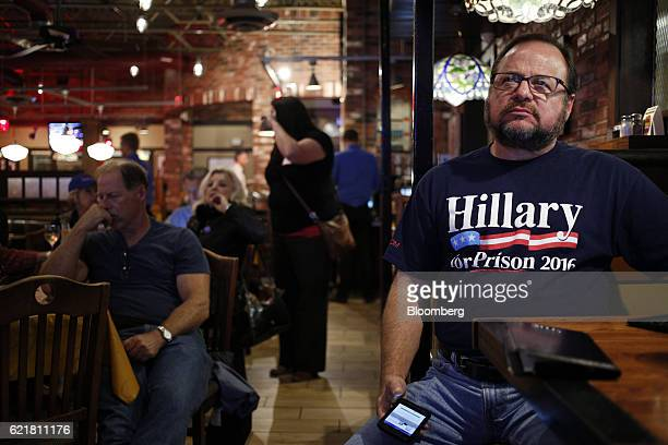 A man wearing a Hillary for Prison shirt watches results during a US presidential election night watch party thrown by thrown by Butler County For...