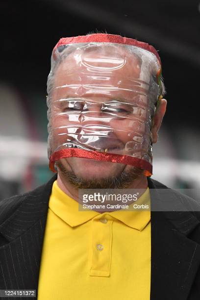 Man wearing a home-made protective mask on the subway platform at Chatelet Les Halles subway Station in Paris on May 11, 2020 in Paris, France....