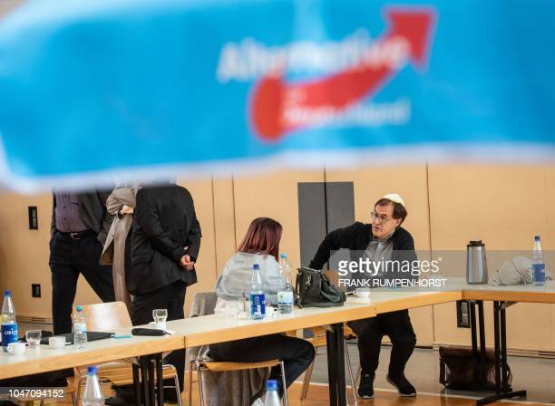 A man wearing a Jewish kippa skullcap talks with another participant of a founding event for a new Jewish grouping within Germany's farright AfD...