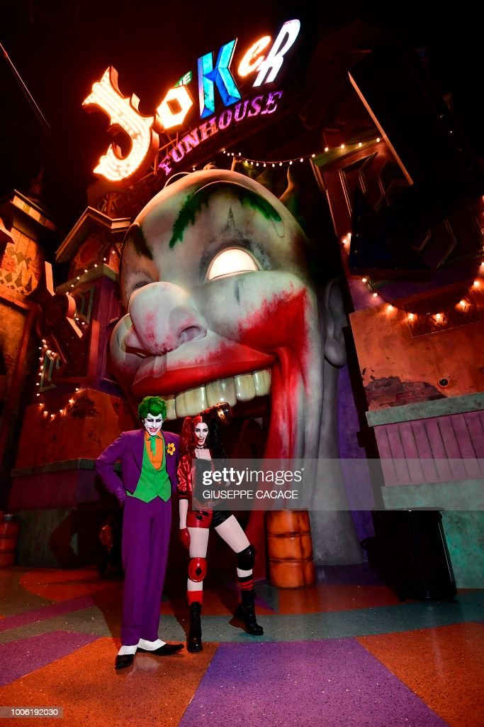 A man wearing a Joker costume and a woman dressed as Harley Quinn pose for a & A man wearing a Joker costume and a woman dressed as Harley Quinn ...