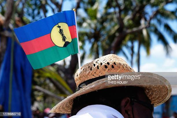 A man wearing a Kanak independence flag on his hat takes part in a symbolic day marking the taking of possession of New Caledonia by France on...