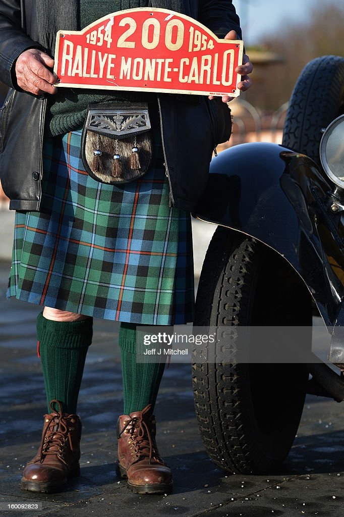 A man wearing a kilt holds a sign ahead ahead of the start of the Monte Carlo Classic Rally on January 26, 2013 in Glasgow. Around 100 cars will set off from The People's Palace at Glasgow Green, they will pass through Kilmarnock and Dumfries on route to Monte Carlo via Dover.