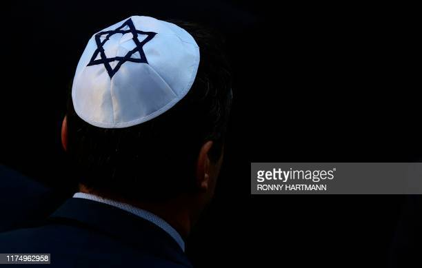 A man wearing a kippah Jewish skullcap arrives at the synagogue in Halle eastern Germany on October 10 one day after the attack where two people were...