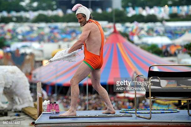 A man wearing a mankini performs on the second day of the Glastonbury Festival of Music and Performing Arts on Worthy Farm near the village of Pilton...