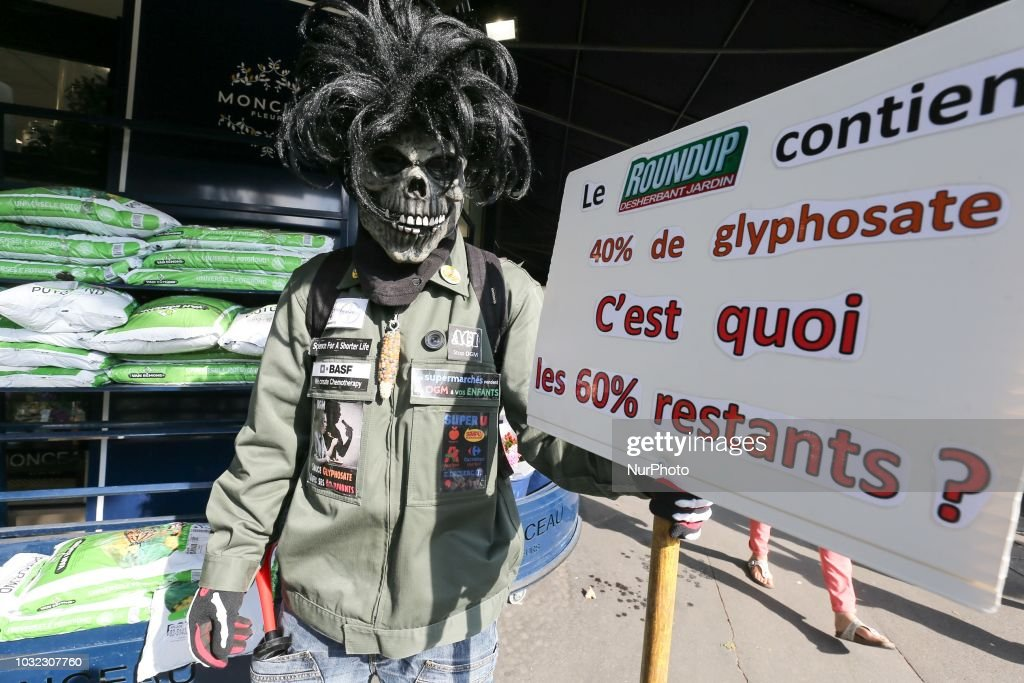 "A man wearing a mask holds a placard which translates as ""Roundup contains 40% of glyphosate, what is the remaining 60 % ? » during a gathering on September 12, 2018, in Paris for the inclusion of the prohibition of glyphosate in the law in France. The French parliaments lower house, the National Assembly, has rejected moves to impose a deadline for phasing out the controversial chemical, which has been linked to cancer."
