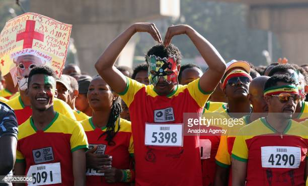 A man wearing a mask in Ethiopian flag colors attends the Great Ethiopian Run at Adwa Square in Addis Ababa Ethiopia on November 26 2017 Total of...