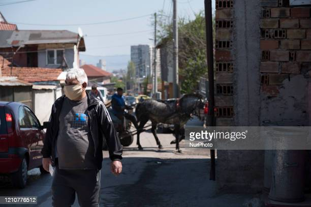 A man wearing a mask in Fakulteta a Roma neighborhood in Sofia Bulgaria on April 23 2020 Fakulteta is one of two Roma neighborhoods quarantined since...