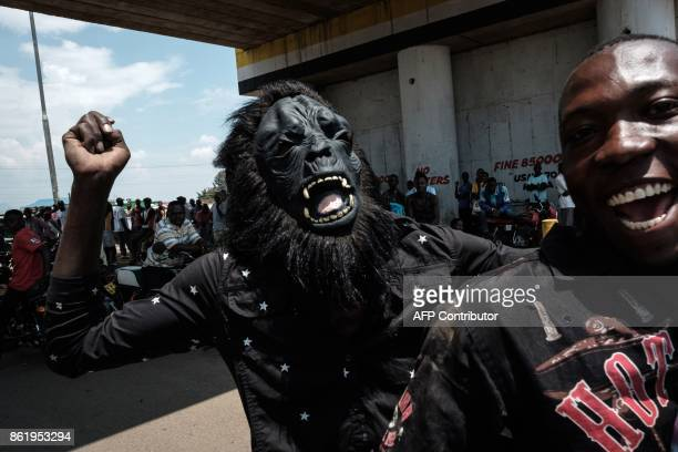 A man wearing a mask of a gorilla takes part in a demonstration on October 16 in Kisumu to demand the removal of officials from the national election...