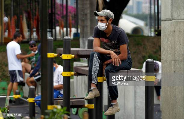 A man wearing a mask wait inside of an accommodation services center at the Carlos Mauro Hoyos Coliseum on April 4 2020 in Medellín Colombia People...