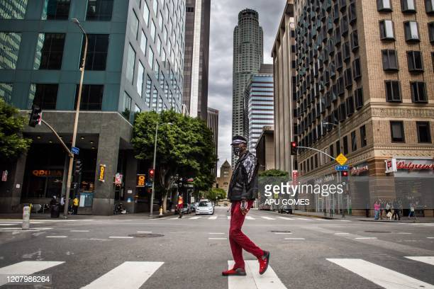 A man wearing a mask walks in Downtown Los Angeles on March 22 during the coronavirus outbreak The US president on March 22 said he had ordered the...