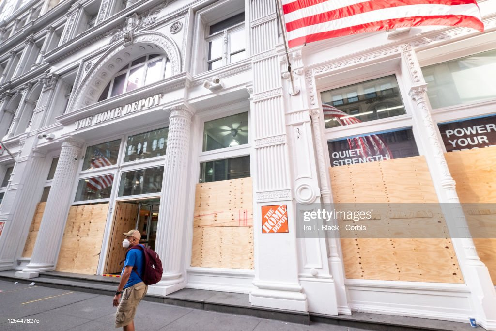 A Man Wearing A Mask Walks Past A Home Depot On 5th Avenue Manhattan News Photo Getty Images