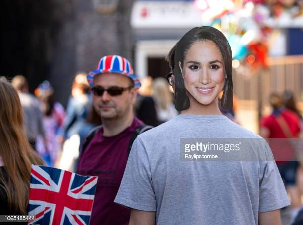 man wearing a megan markle face mask while celebrating the marriage of meghan markle and prince harry at st george's chapel at windsor castle - meghan stock photos and pictures