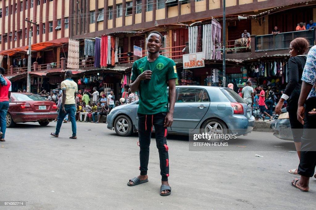 1841a79e FBL-WC2018-NGR-FEATURE. A man wearing a Nigerian World Cup jersey ...
