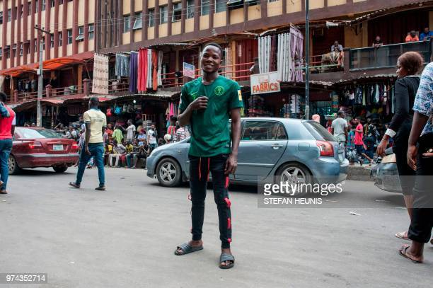 481bf68c3 A man wearing a Nigerian World Cup jersey poses for a photo in Balogun  Market in
