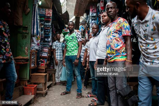 df9bcc95b ... seen in Balogun Market in Lagos on June. ED. Editorial use only. A man  wearing a Nigerian World Cup jersey poses for a photo in one of the