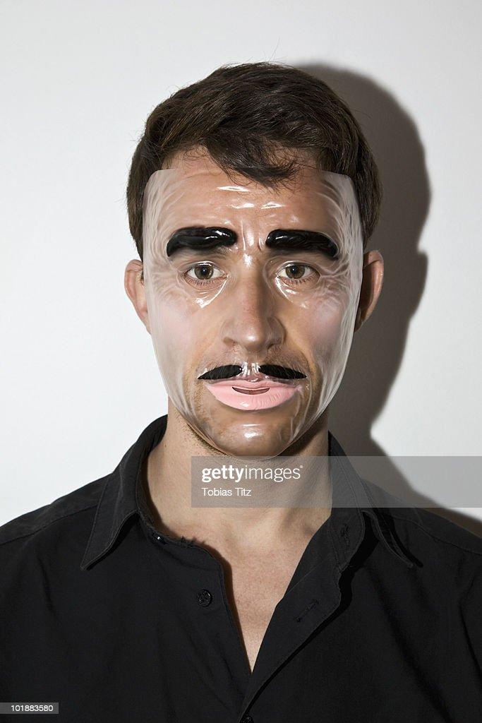 A man wearing a novelty mask,  Melbourne, Victoria, Australia : Stock Photo