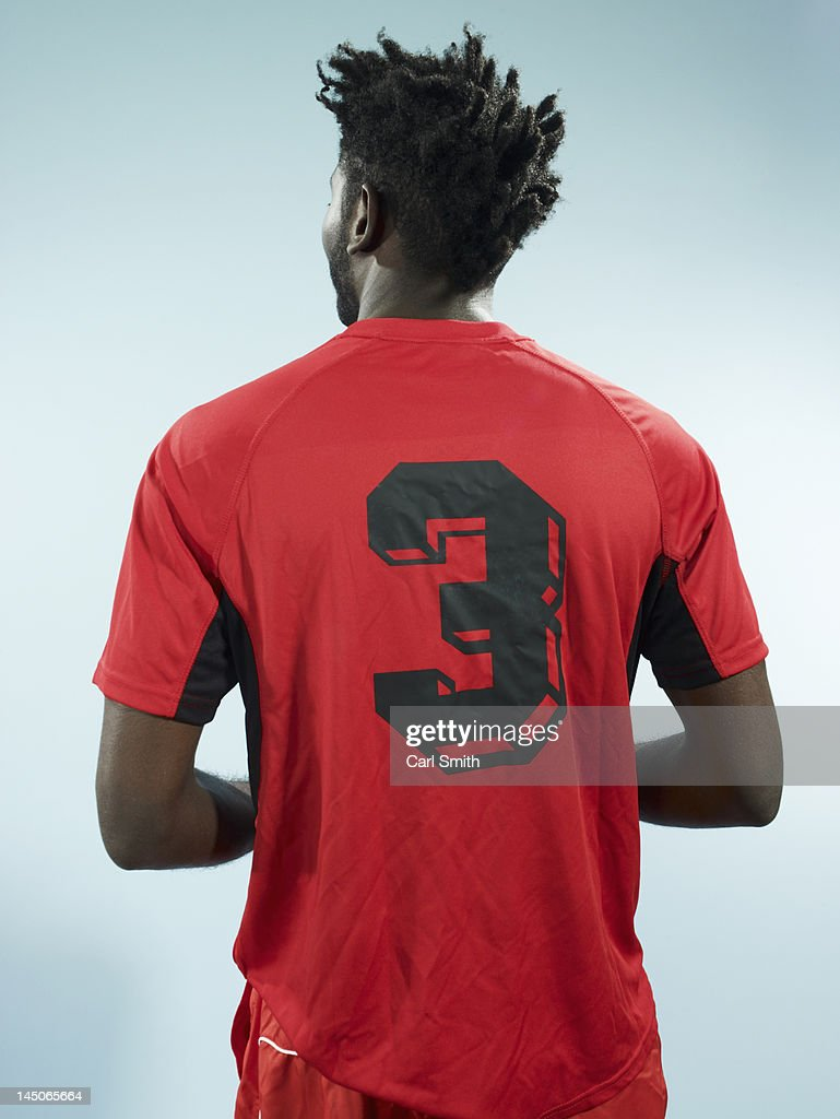 A man wearing a numbered soccer shirt : Stock Photo