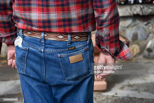 A man wearing a pair of Wrangler brand jeans in Santa Fe New Mexico