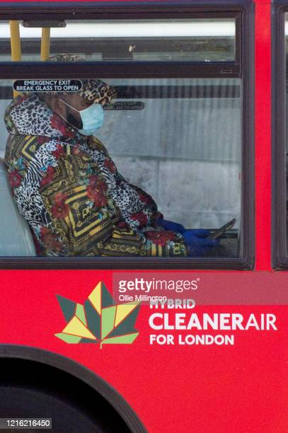 Man wearing a personal protection mask on a bus at Tower Bridge on March 31, 2020 in London, England. British Prime Minister, Boris Johnson,...
