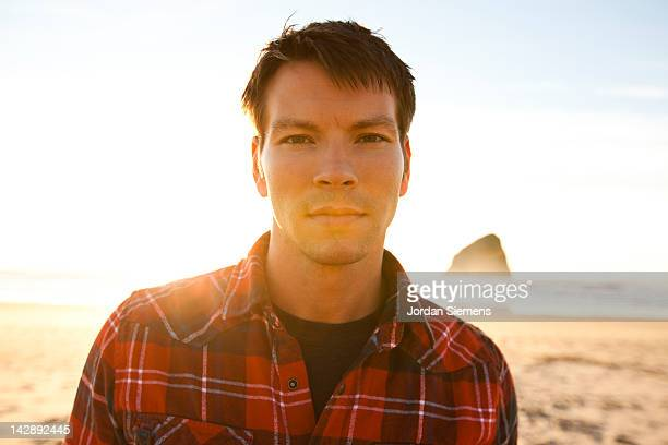 Man wearing a plaid shirt.