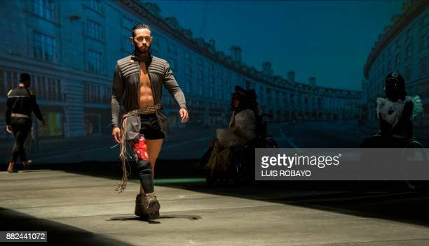 A man wearing a prosthesis on his leg models a creation by Colombian designer Guio Di Colombia during the Walkway Inclusion fashion show in Cali...
