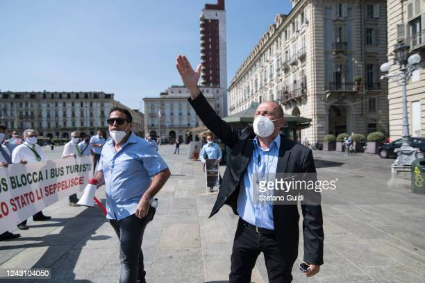 A man wearing a protective face mask gestures during a demonstration by bus drivers against the Italian Government for the economic problems the...