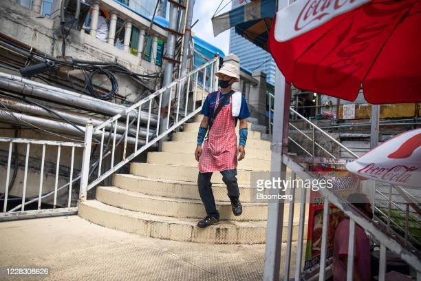 A man wearing a protective mask descends a flight of stairs in Bangkok Thailand on Wednesday Sept 2 2020 Thailand has reported zero...