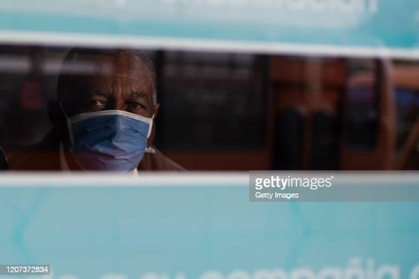 A man wearing a protective mask poses for a picture inside a private health center on the 1st day of city closure during the Quarantine in the...
