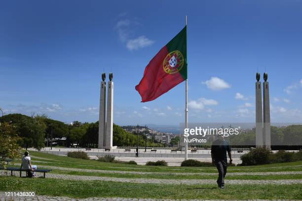 Man wearing a protective mask walks around the Educardo VII park in Lisbon, May 01, 2020. Portuguese Prime Minister António Costa announced on...