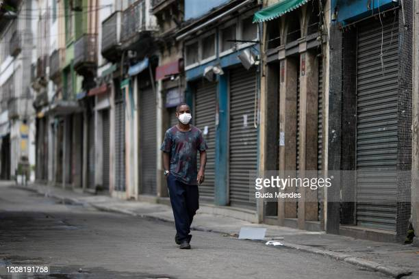 A man wearing a protective mask walks in a nearly empty Saara region a large shopping area in the center the city during a lockdown aimed at stopping...