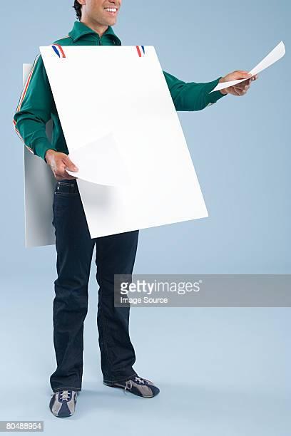 A man wearing a sandwich board