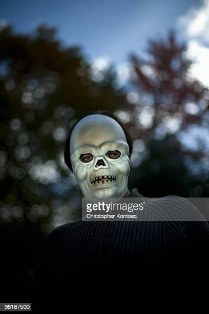 A man wearing a scary Halloween mask