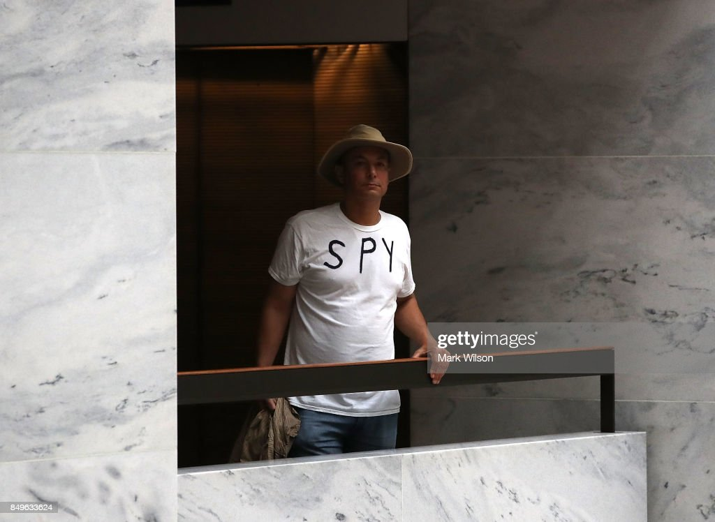 A man wearing a shirt that says 'Spy' stands near where the Senate Intelligence Committee is meeting, on September 19, 2017 in Washington, DC. The committee is investigating alleged Russian interference in the 2016 U.S. presidential election.