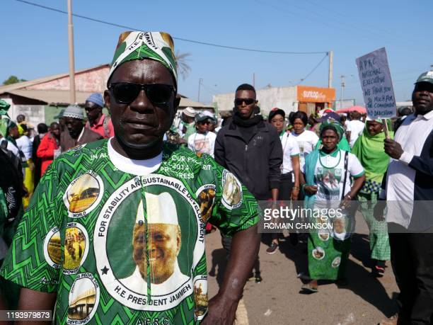 Man wearing a shirt with Yahya Jammeh, Gambia's former dictator, picture on poses for a portrait during a demonstration for Yahya Jammeh's return, in...