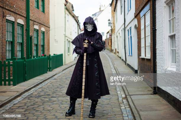 A man wearing a skull mask poses for a picture during Whitby Goth Weekend on October 28 2018 in Whitby England Whitby Goth weekend began in 1994 and...
