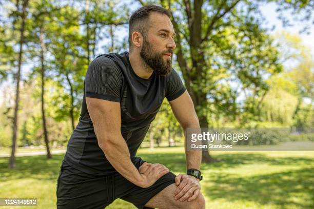 man wearing a smart watch or fitness tracker on his hand - dusan stankovic stock pictures, royalty-free photos & images
