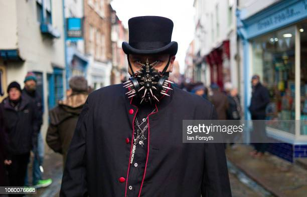 A man wearing a steam punk style face mask poses for a photograph during Whitby Goth Weekend on October 27 2018 in Whitby England The Whitby Goth...