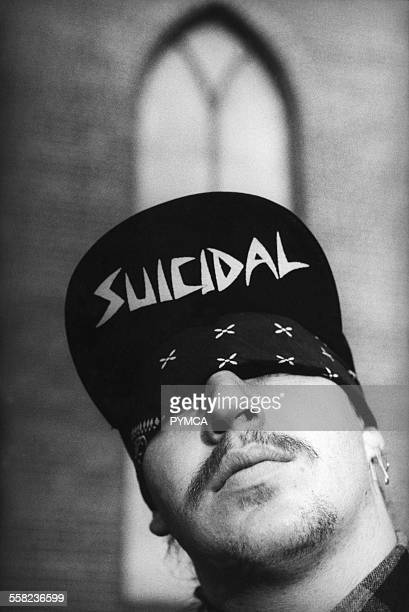 A man wearing a Suicidal Tendencies Cap with a bandana covering his eyes USA 1980s