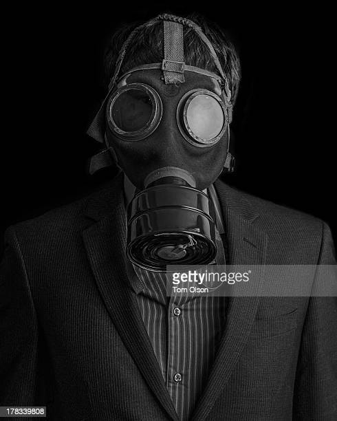 Man Wearing a Suit And a Gas Mask