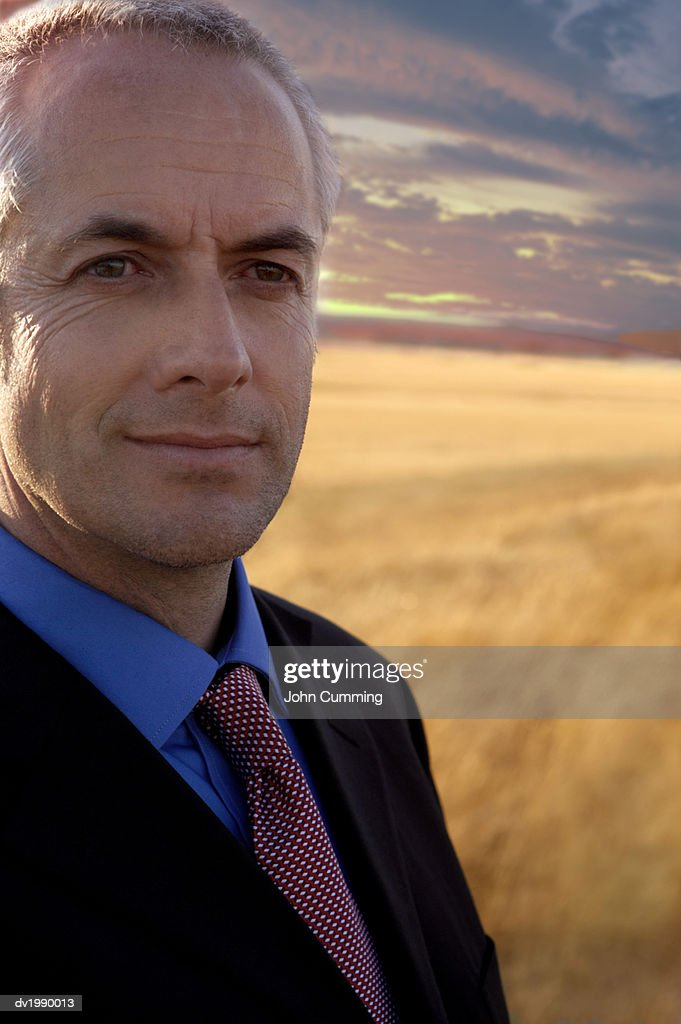 Man Wearing a Suit in a Field : Stock Photo